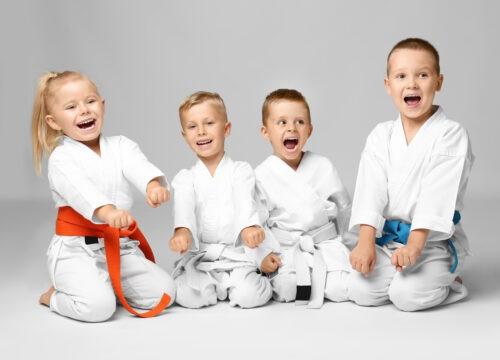 Little children in karategi on light background